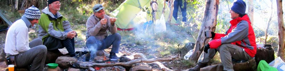 Bushwalkers around the camp fire enjoy a camping trip