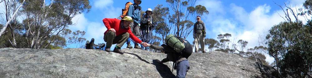 Bushwalkers demonstrate fitness ascending a rockface